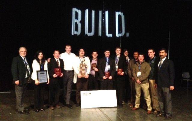 The NAHB Student Chapter from Michigan State University receives the first-place trophy for winning the Four-Year Colleges Category of the Residential Construction Management Competition at the 2013 NAHB International Builders' Show.